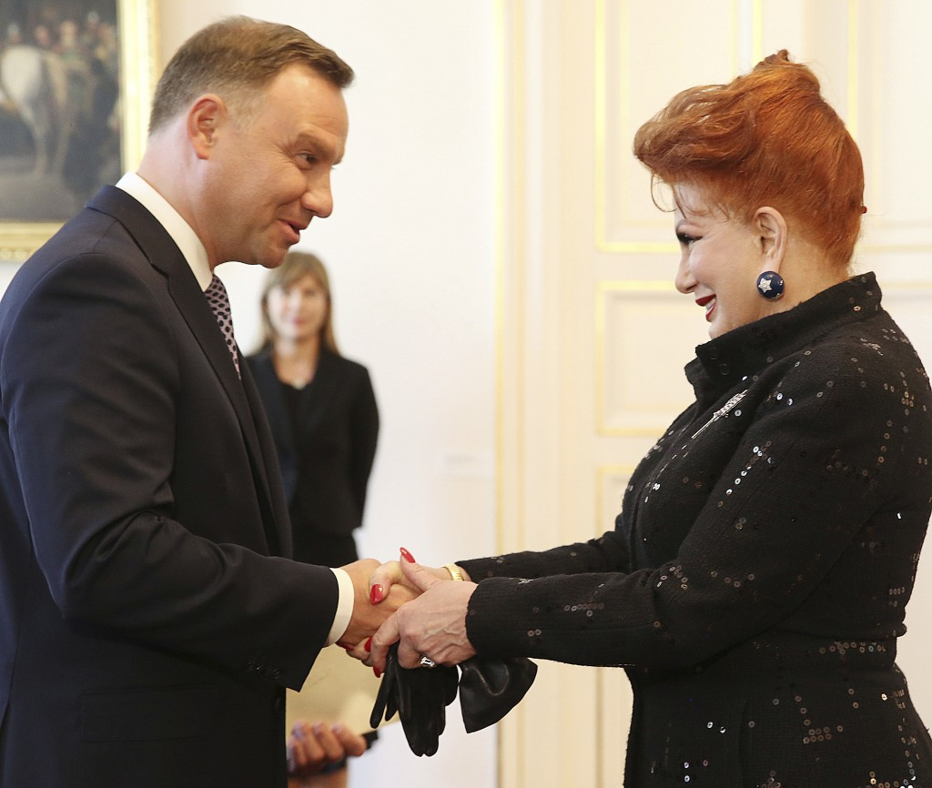 Georgette Mosbacher, right, shakes hand with Polish President Andrzej Duda during a ceremony receiving her credentials as new United States ambassador