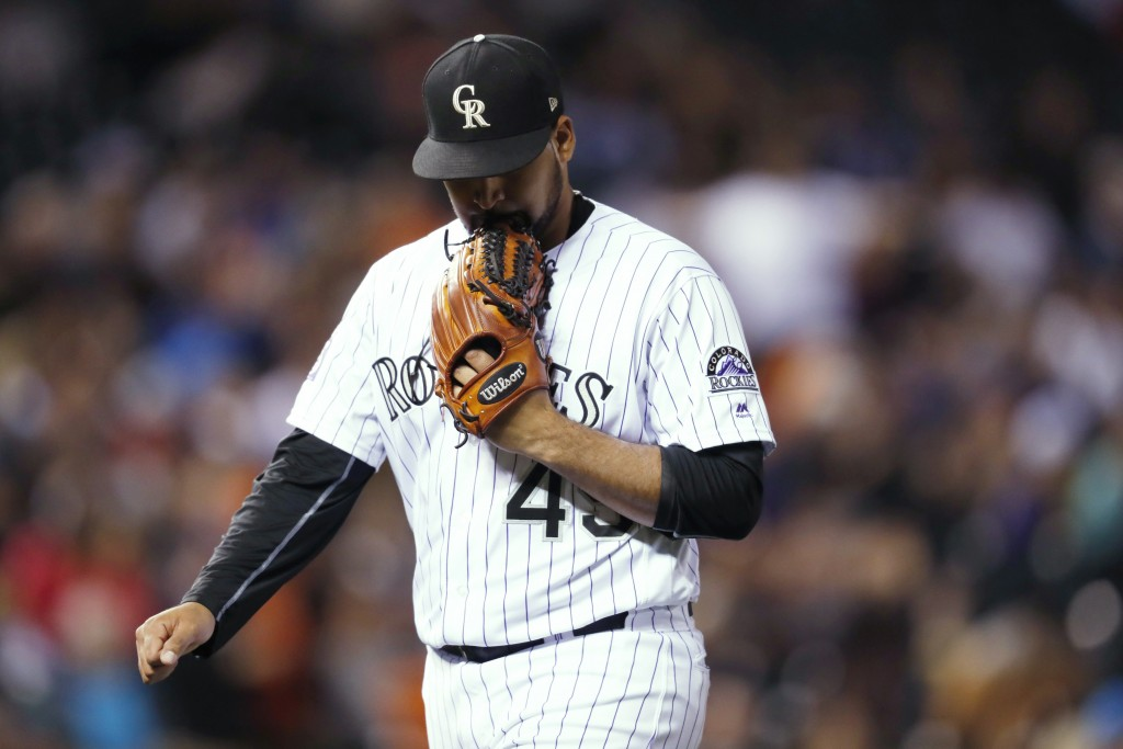 Colorado Rockies starting pitcher Antonio Senzatela bites his glove as he heads to the dugout after the top of the third inning against the San Franci...