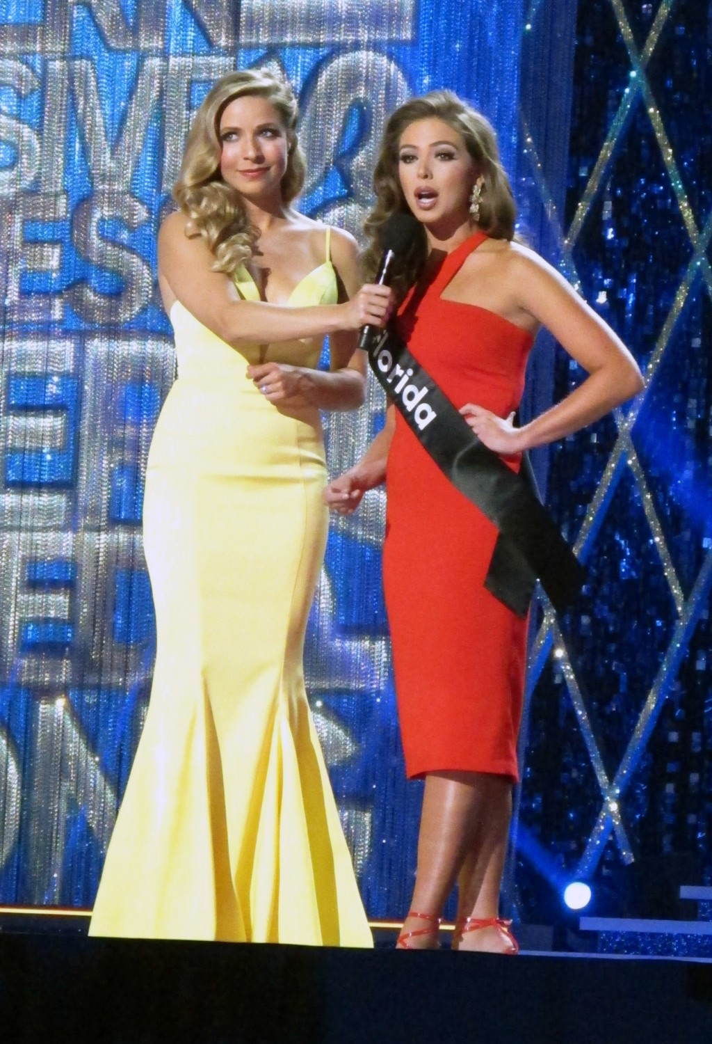 Miss America 2015 Kira Kazantsev, left, conducts an onstage interview with Miss Florida Taylor Tyson during the second night of preliminary competitio...