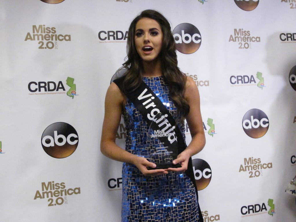 Miss Virginia Emili McPhail speaks with reporters after winning the onstage interview portion of the second night of preliminary competition in the Mi...