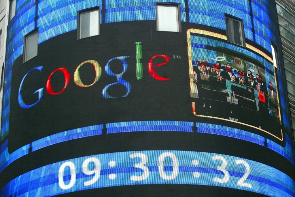FILE- In this Aug. 19, 2004, file photo the sign outside the Nasdaq Marketsite shows a picture of Goggle staff attending the opening of the Nasdaq mar...