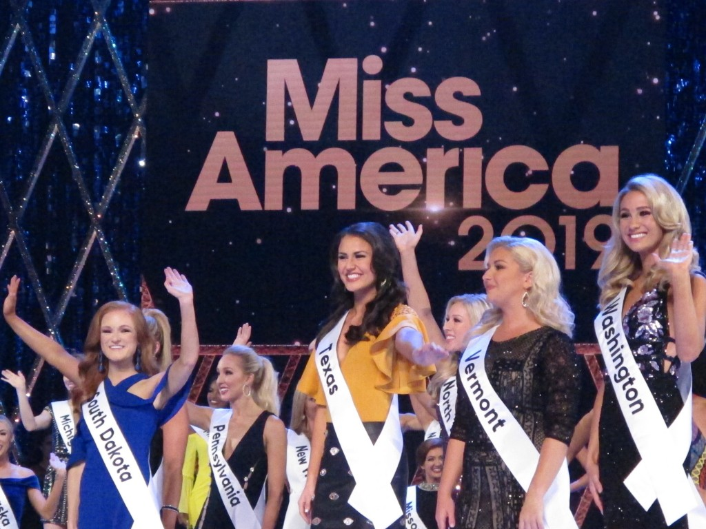 Contestants wave to the audience during introductions at the second night of preliminary competition at the Miss America competition in Atlantic City ...