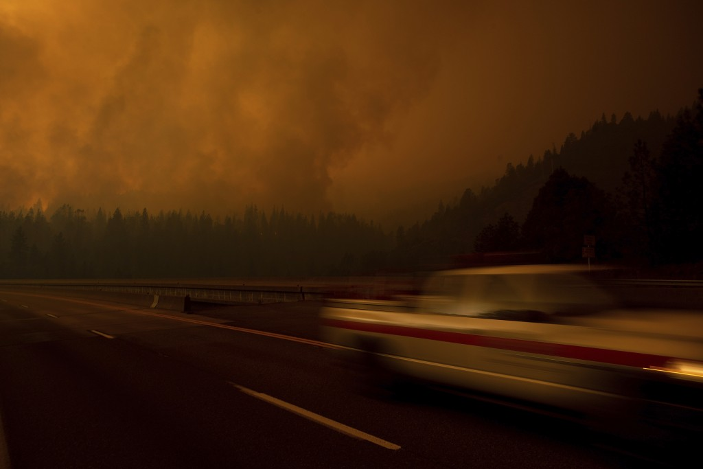 A fire vehicle drives along Interstate 5 as the Delta Fire burns in the Shasta-Trinity National Forest, Calif., on Thursday, Sept. 6, 2018. The highwa