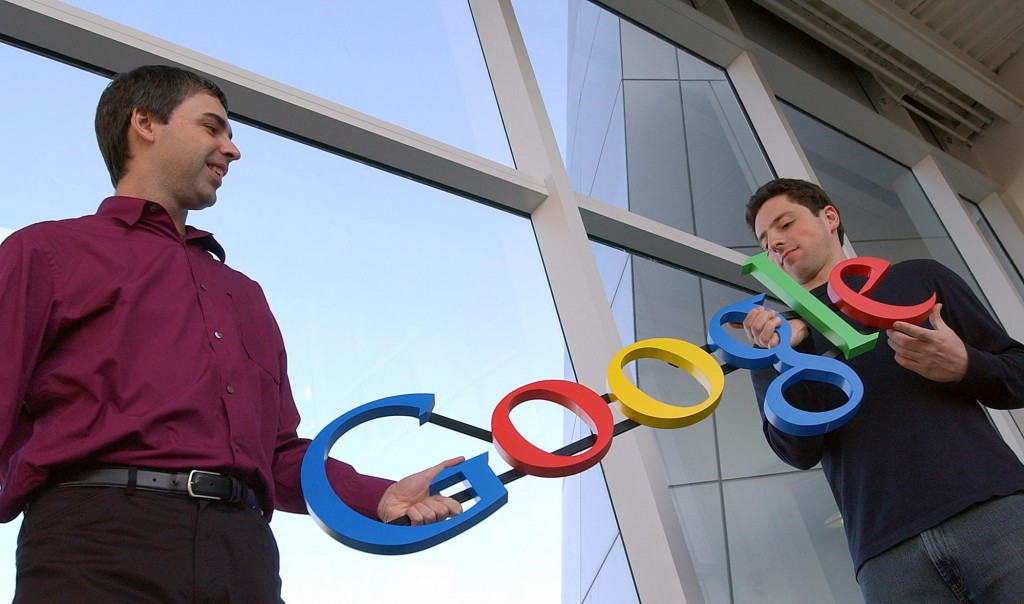 FILE- In this Jan. 15, 2004, file photo Google co-founders Larry Page, left, and Sergey Brin pose for a photo at their company's headquarters in Mount...