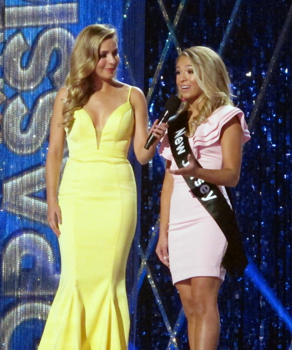Miss America 2015 Kira Kazantsev, left, conducts an onstage interview with Miss New Jersey Jaime Gialloreto during the second night of preliminary com...