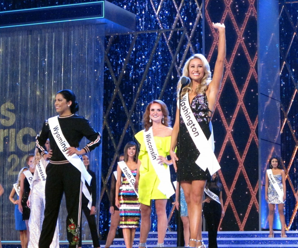 Danamarie McNicholl, Miss Washington, introduces herself during the second night of preliminary competition in the Miss America competition in Atlanti...