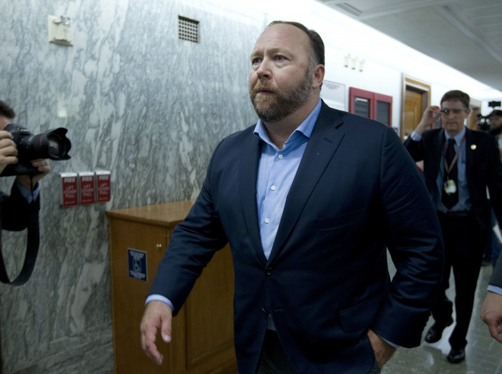 FILE - In this Wednesday, Sept. 5, 2018 file photo, Alex Jones, the right-wing conspiracy theorist, walks the corridors of Capitol Hill after listenin...