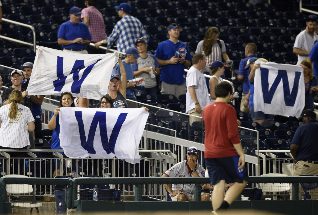 Chicago Cubs fans wave flags after a baseball game between the Washington Nationals and the Chicago Cubs, Thursday, Sept. 6, 2018, in Washington. The ...