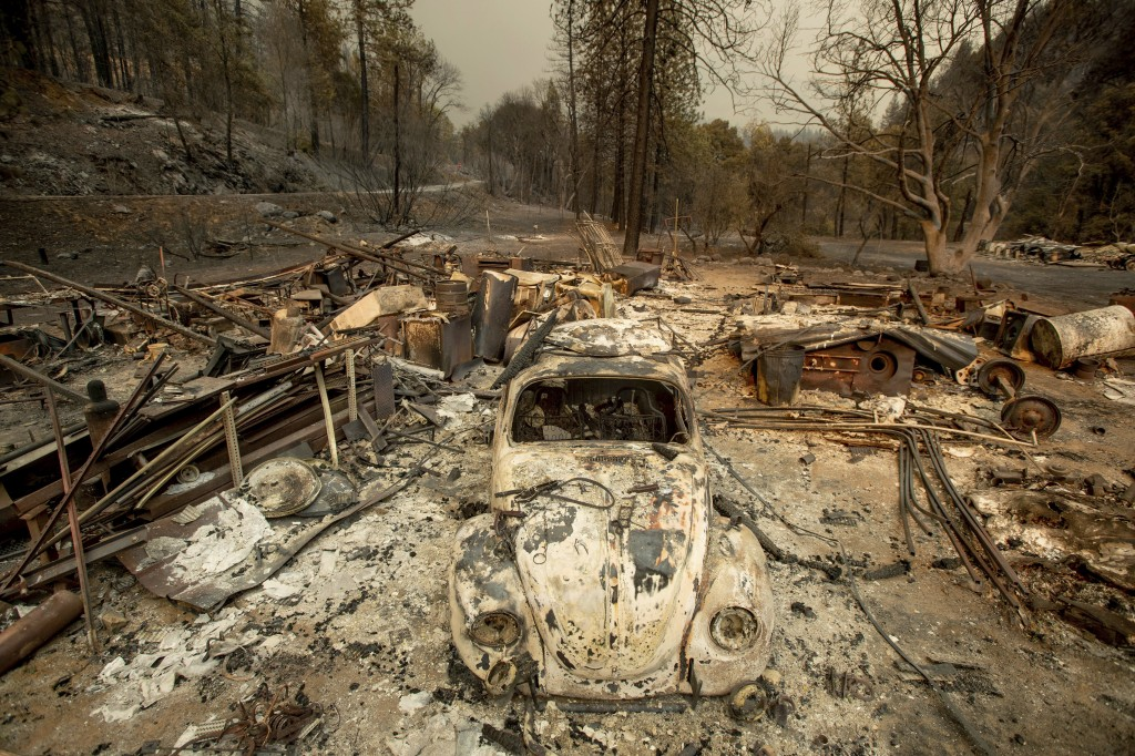A scorched VW Beetle rests in a clearing after the Delta Fire burned through the Lamoine community in the Shasta-Trinity National Forest, Calif., on T
