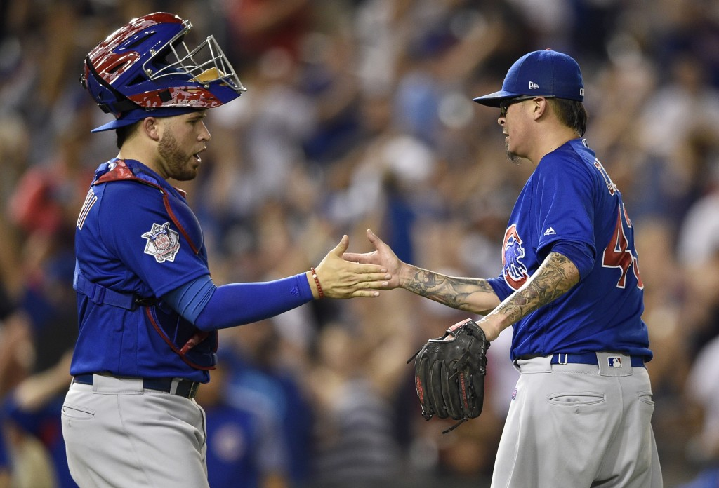 Chicago Cubs relief pitcher Jesse Chavez, right, celebrates with catcher Victor Caratini (7) after a baseball game against the Washington Nationals, T