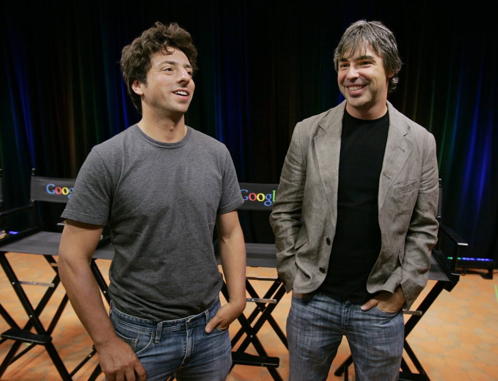 FILE - In this Sept. 2, 2008 file photo, Google co-founders Sergey Brin, left, and Larry Page talk during a new conference at Google Inc. headquarters...