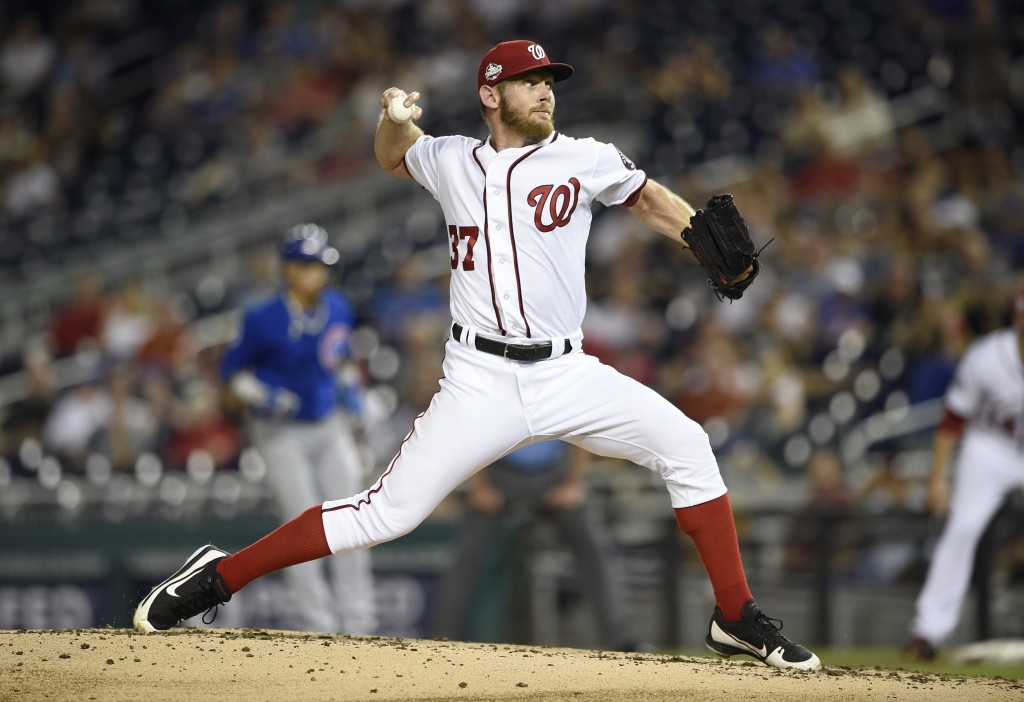 Washington Nationals starting pitcher Stephen Strasburg delivers during the third inning of a baseball game against the Chicago Cubs, Thursday, Sept. ...