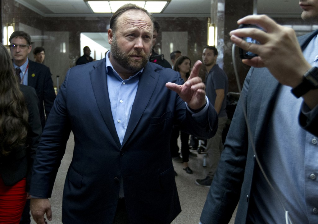 FILE - In this Wednesday, Sept. 5, 2018, file photo, Alex Jones, the right-wing conspiracy theorist, walks the corridors of Capitol Hill after listeni...