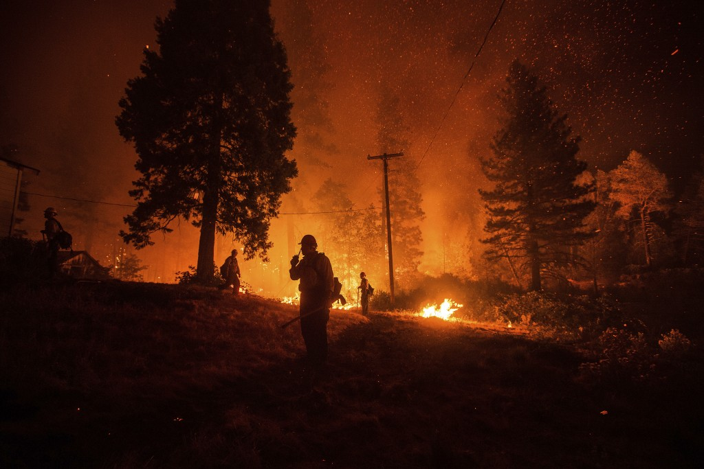 Firefighters monitor a backfire while battling the Delta Fire in the Shasta-Trinity National Forest, Calif., on Thursday, Sept. 6, 2018. The wildfire