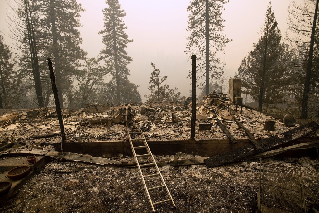 A home leveled by the Delta Fire rests in a clearing in Pollard Flat area of the Shasta-Trinity National Forest, Calif., on Thursday, Sept. 6, 2018. (