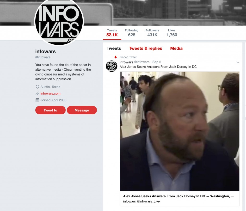 This image shows a post on Info Wars' Twitter account showing right-wing conspiracy theorist Alex Jones questioning CNN journalist Oliver Darcy on Wed...