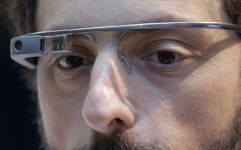 FILE - In this Feb. 20 2013, file photo, Google co-founder Sergey Brin wears a Google Glass device in San Francisco. Twenty years after Larry Page and...
