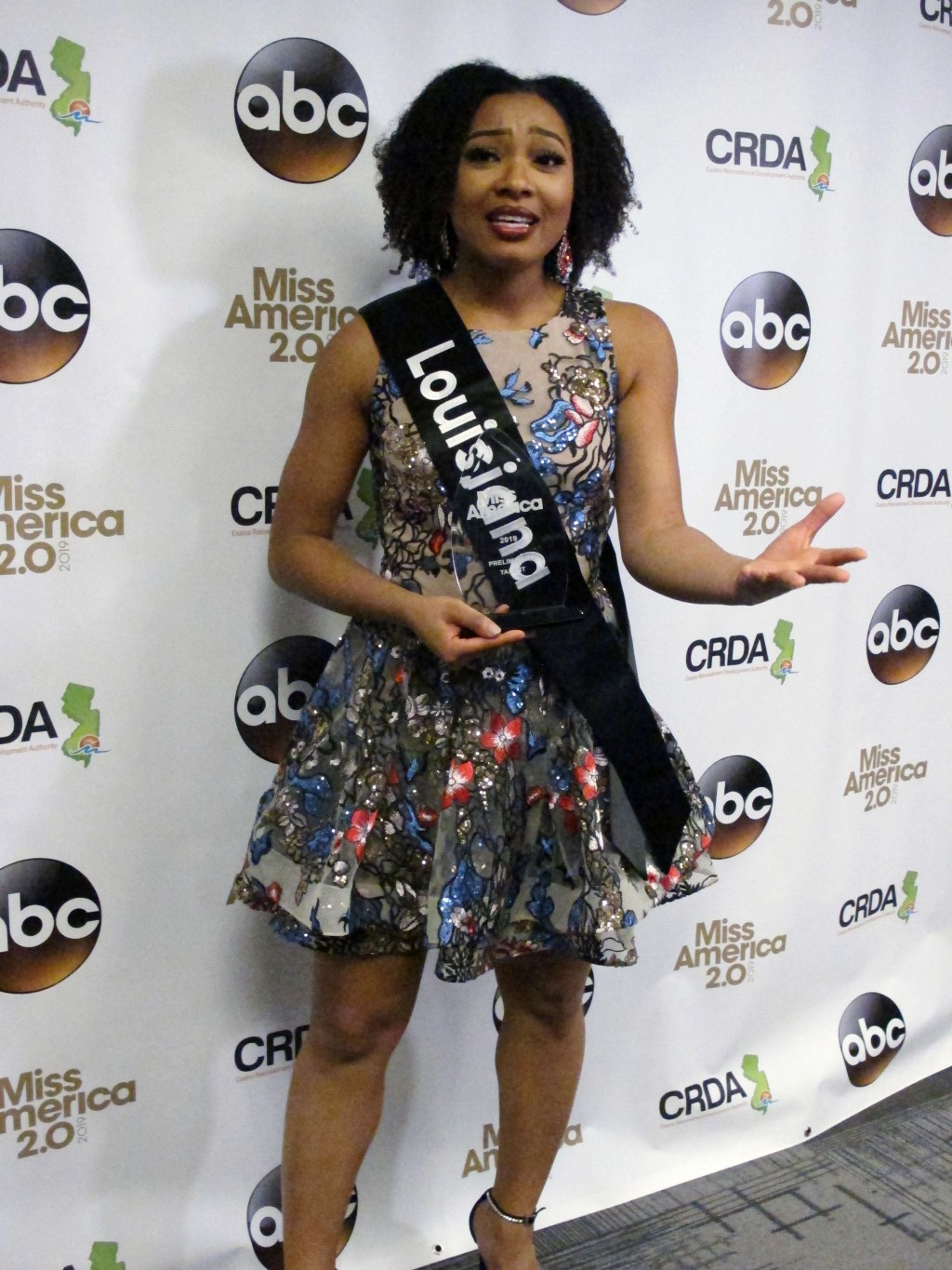 Miss Louisiana Holli' Conway speaks with reporters after winning the talent portion of the second night of preliminary competition in the Miss America...