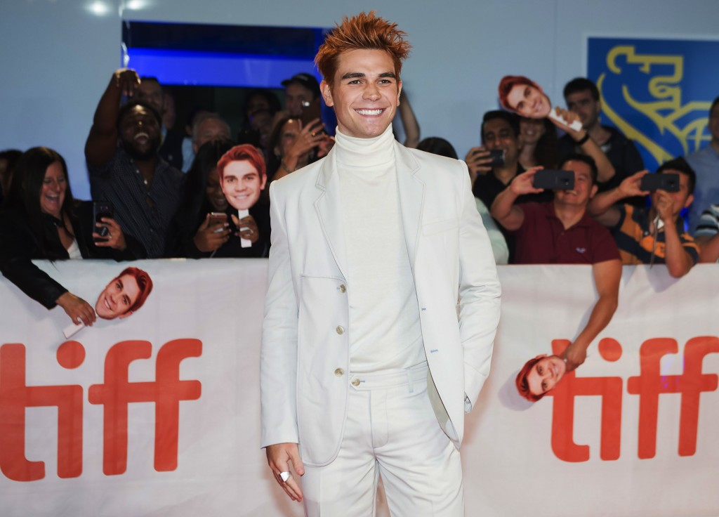 "Actor KJ Apa poses for photographs on the red carpet after arriving for the new movie ""The Hate U Give"" during the 2018 Toronto International Film Fes"