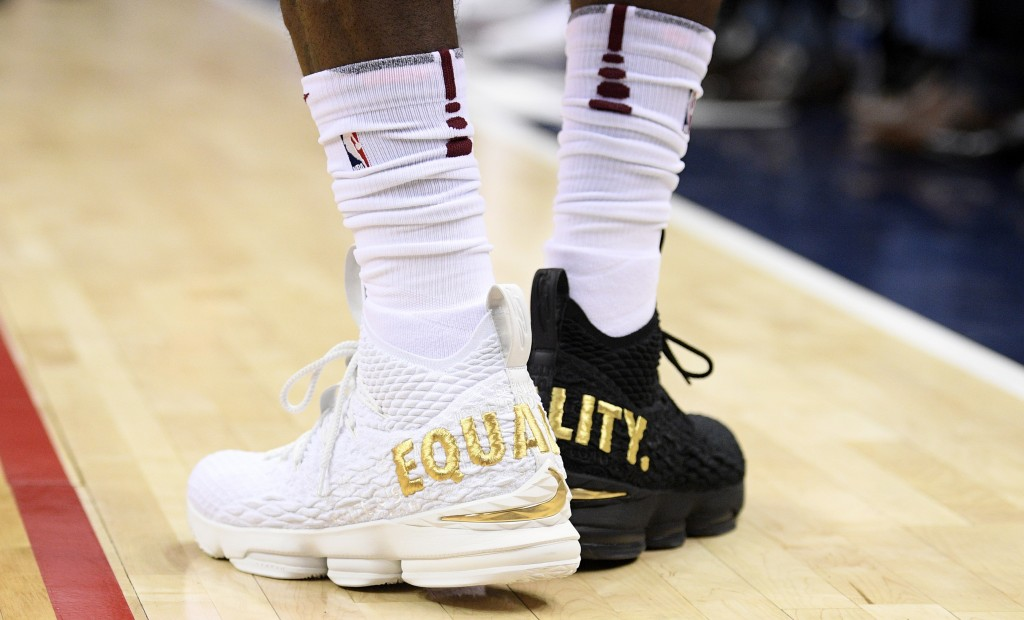"""FILE- In this Dec. 17, 2017, file photo Cleveland Cavaliers forward LeBron James' shoes are emblazoned with """"EQUALITY"""" on both heels during the first ..."""