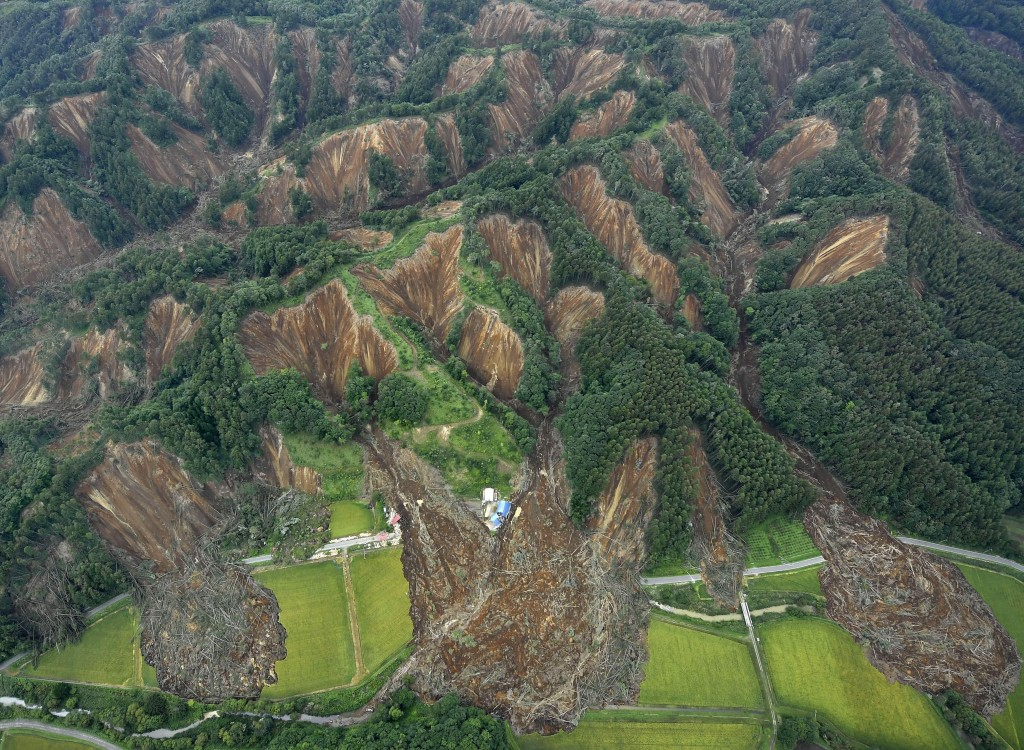 Landslides are seen after Thursday's earthquake in Atsuma, Hokkaido, northern Japan Saturday, Sept. 8, 2018. Japanese rescue workers and troops search