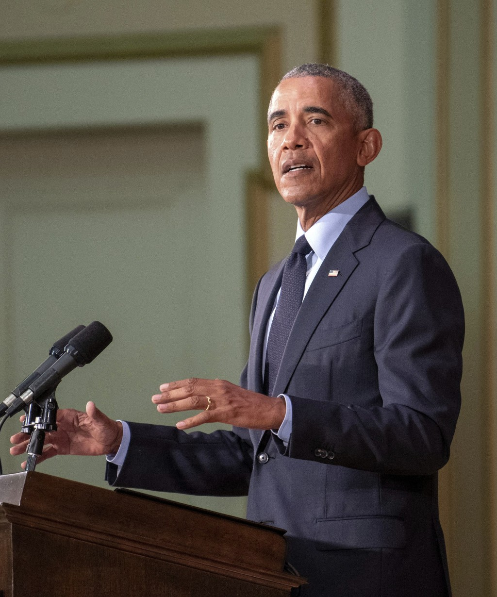 Former President Barack Obama speaks to a full crowd in Foellinger Auditorium Friday, Sept. 7, 2018, on the University of Illinois campus in Urbana. O