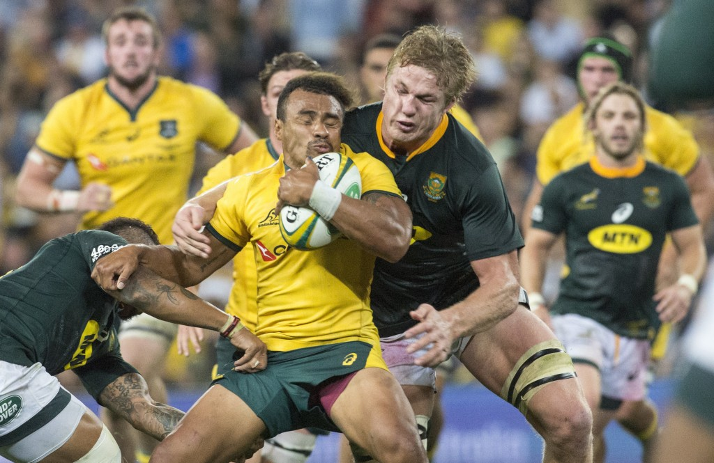 Australia's Will Genia with the ball for the Wallabies is monstered by Pieter-Steph Du Toit of the Springboks during their rugby union test match in B