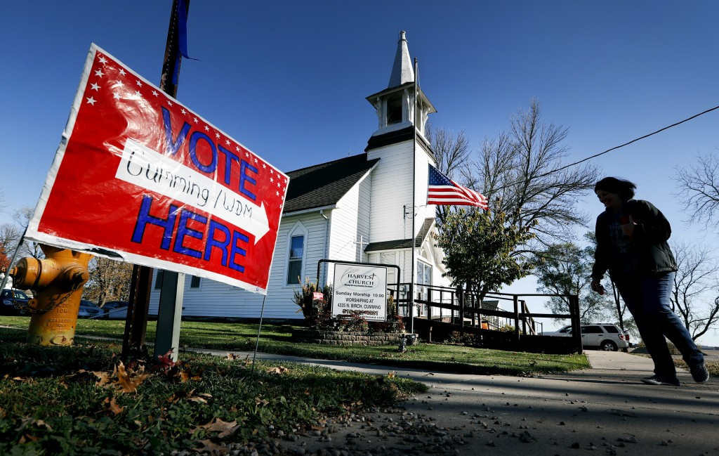 FILE - In this Tuesday, Nov. 8, 2016 file photo, a local resident leaves a church after voting in the general election in Cumming, Iowa. Religion's ro...