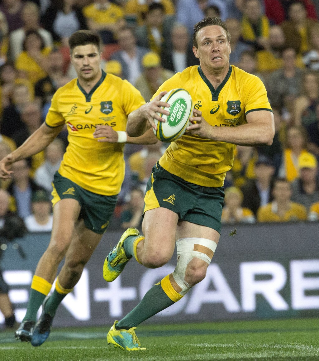 Dane Haylett-Petty of Australia runs the ball against South Africa, during their rugby union test match in Brisbane, Australia, Saturday, Sept. 8, 201