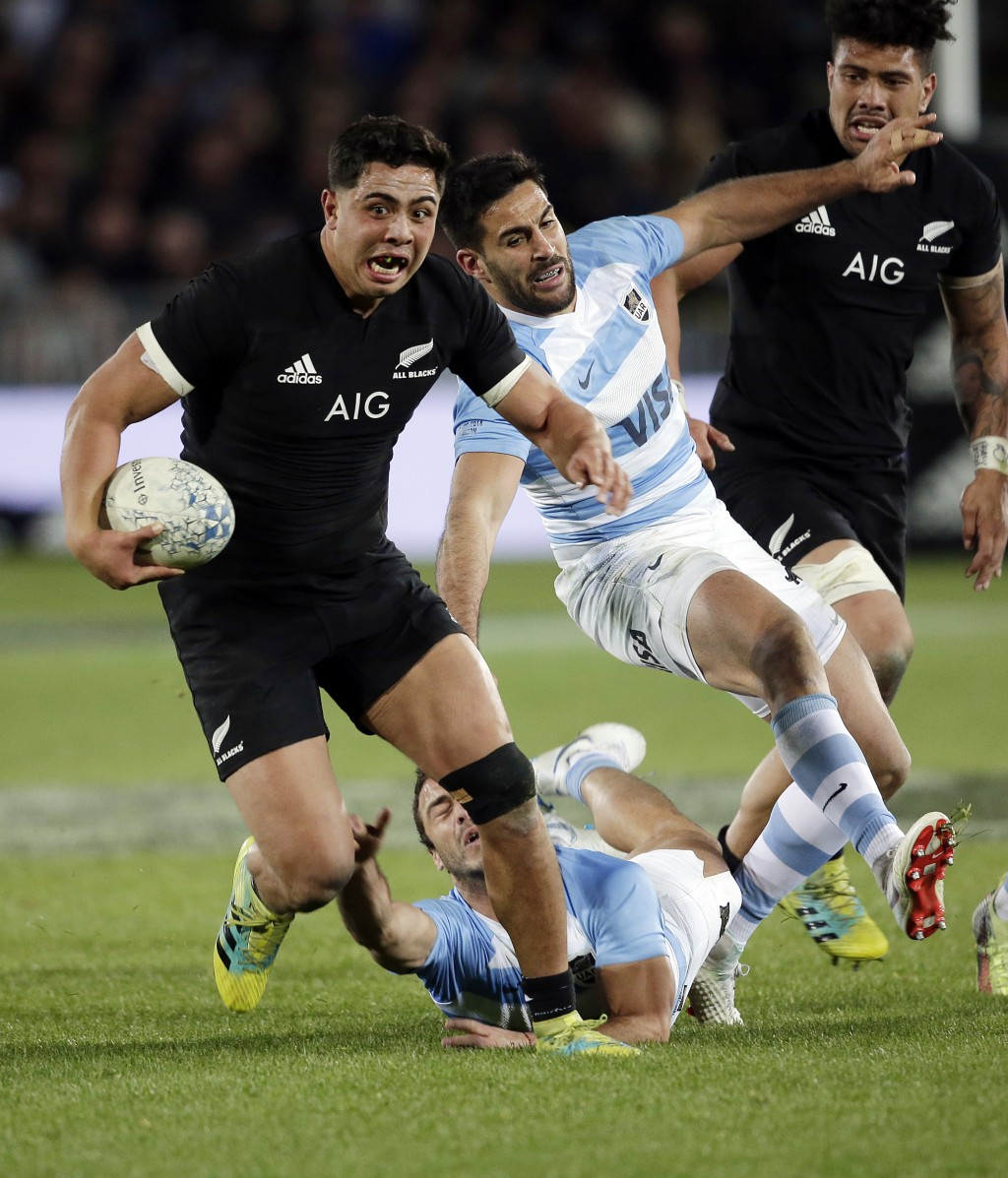 All Blacks Anton Lienert-Brown, left, attacks against the Pumas at Trafalgar Park in Nelson, New Zealand, Saturday, Sept. 8, 2018. (AP Photo/Anthony P
