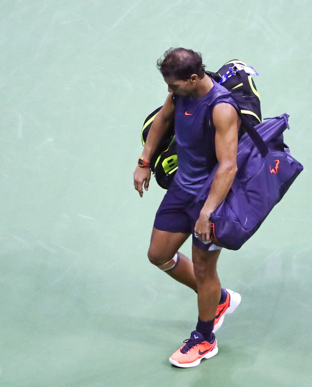 Rafael Nadal, of Spain, leaves the court after retiring from a match against Juan Martin del Potro, of Argentina, during the semifinals of the U.S. Op
