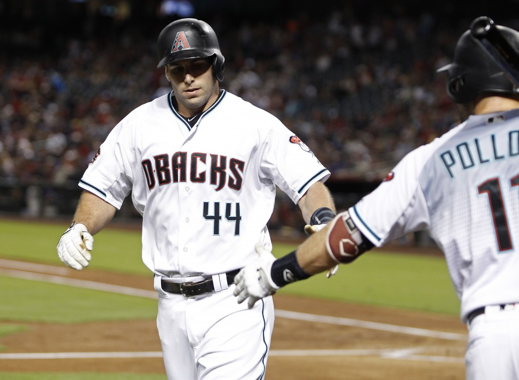 Arizona Diamondbacks' Paul Goldschmidt (44) is congratulated by teammate A.J. Pollock after hitting a solo home run against the Atlanta Braves during ...