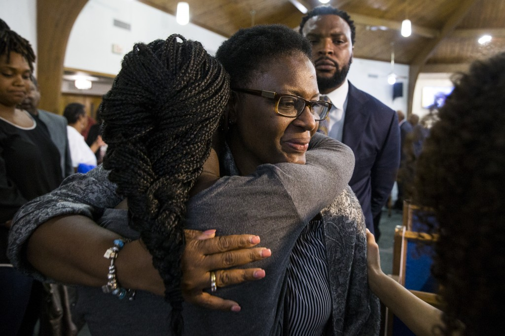 Allison Jean embraces hers son's friends following a prayer vigil for Botham Shem Jean at the Dallas West Church of Christ on Saturday, Sept. 8, 2018