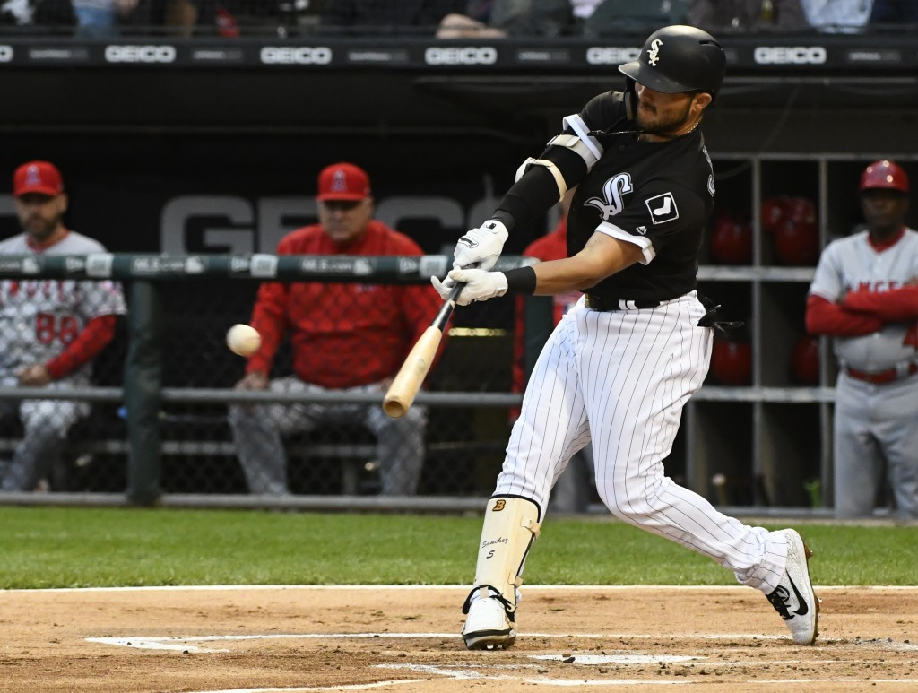 Chicago White Sox's Yolmer Sanchez (5) hits an RBI double during the first inning of a baseball game against the Los Angeles Angels on Saturday, Sept....