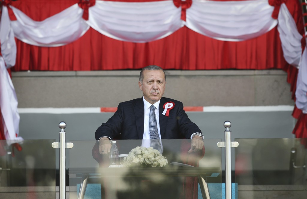 FILE - In this Thursday, Aug. 30, 2018 file photo, Turkey's President Recep Tayyip Erdogan attends a military graduation ceremony on Victory Day, in A