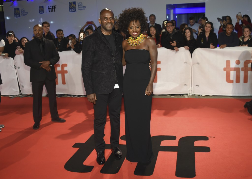 """Julius Tennon, left, and Viola Davis attend the premiere for """"Widows"""" on day 3 of the Toronto International Film Festival at Roy Thomson Hall on Satur"""
