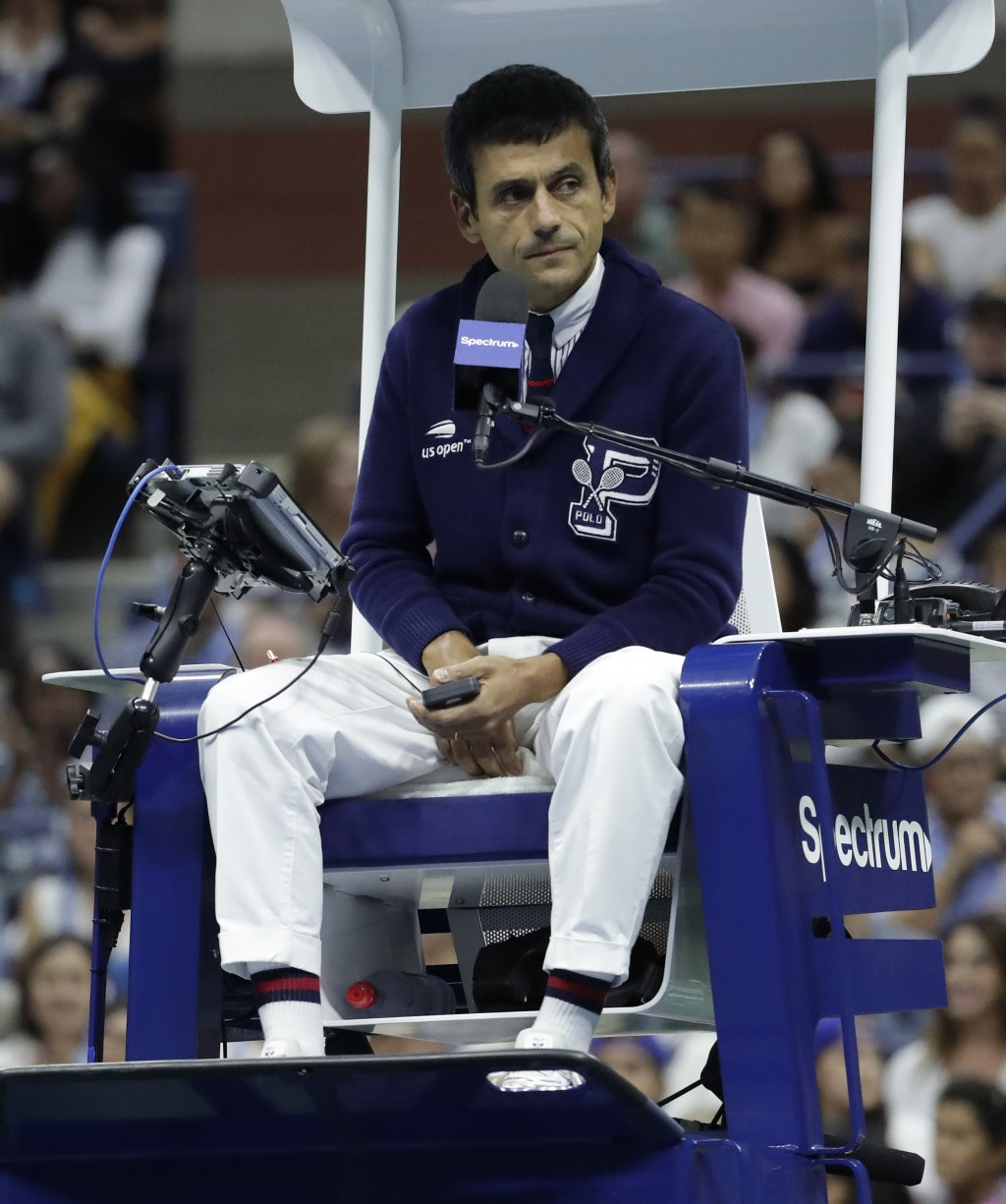 Chair umpire Carlos Ramos watches play as he officiates the match between Serena Williams and Naomi Osaka, of Japan, during the women's final of the U