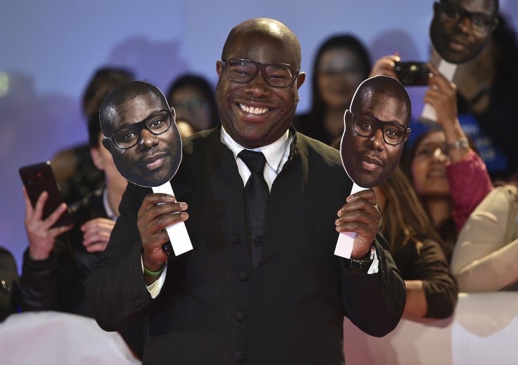 "Director Steve McQueen poses with paper cutouts of his face as he attends the premiere for ""Widows"" on day 3 of the Toronto International Film Festiva"