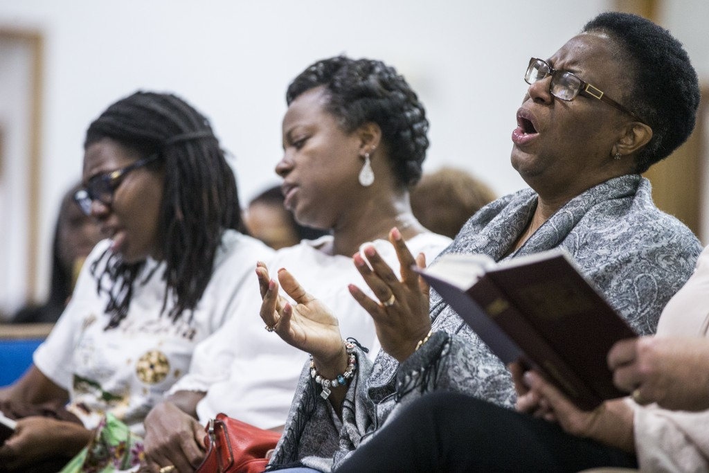Allison Jean, mother of Botham Shem Jean, sings during a prayer vigil for her son at the Dallas West Church of Christ on Saturday, Sept. 8, 2018 in Da