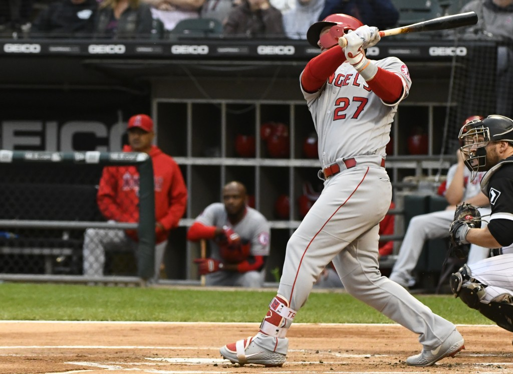 Los Angeles Angels' Mike Trout (27) hits a two run home run during the first inning of a baseball game against the Chicago White Sox on Saturday, Sept...