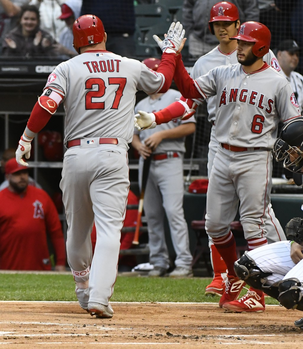 Los Angeles Angels' Mike Trout (27) high fives David Fletcher (6) after they scored on Trout's two run home run during the first inning of a baseball ...