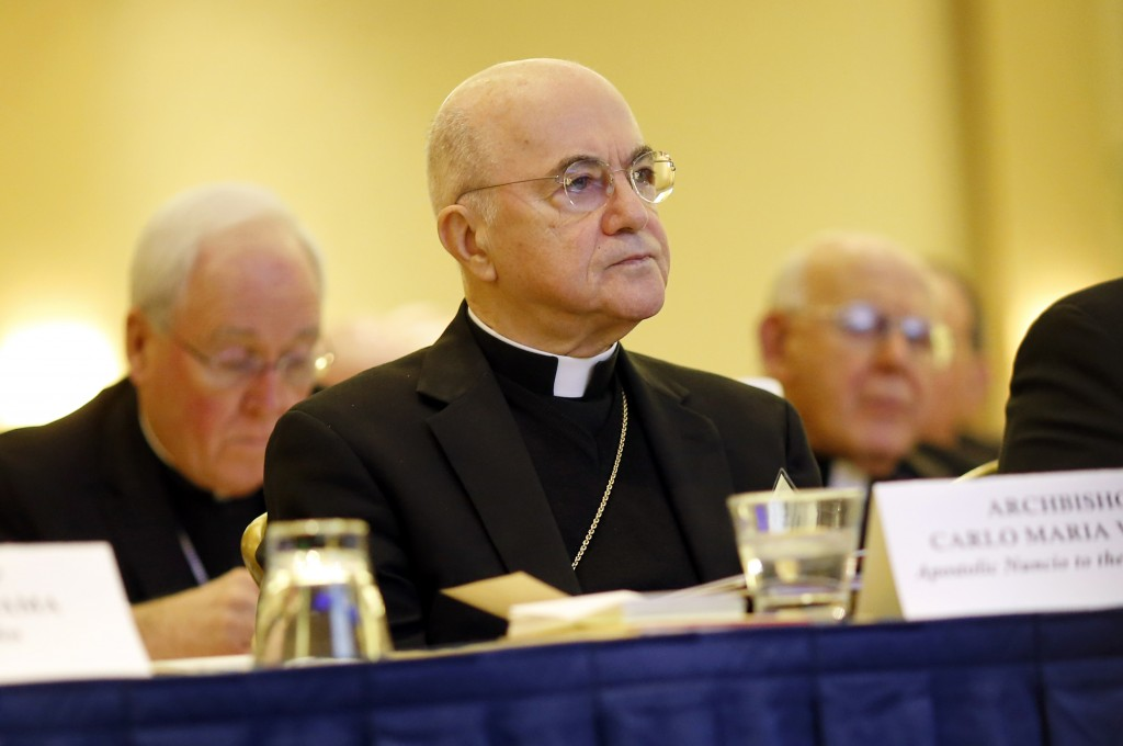 FILE - In this Nov. 16, 2015 file photo, Archbishop Carlo Maria Vigano, Apostolic Nuncio to the U.S., listens to remarks at the U.S. Conference of Cat