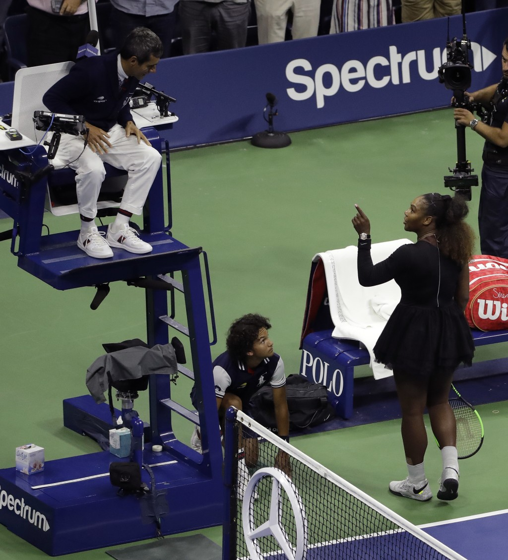 Serena Williams talks with chair umpire Carlos Ramos after being defeated by Naomi Osaka, of Japan, in the women's final of the U.S. Open tennis tourn