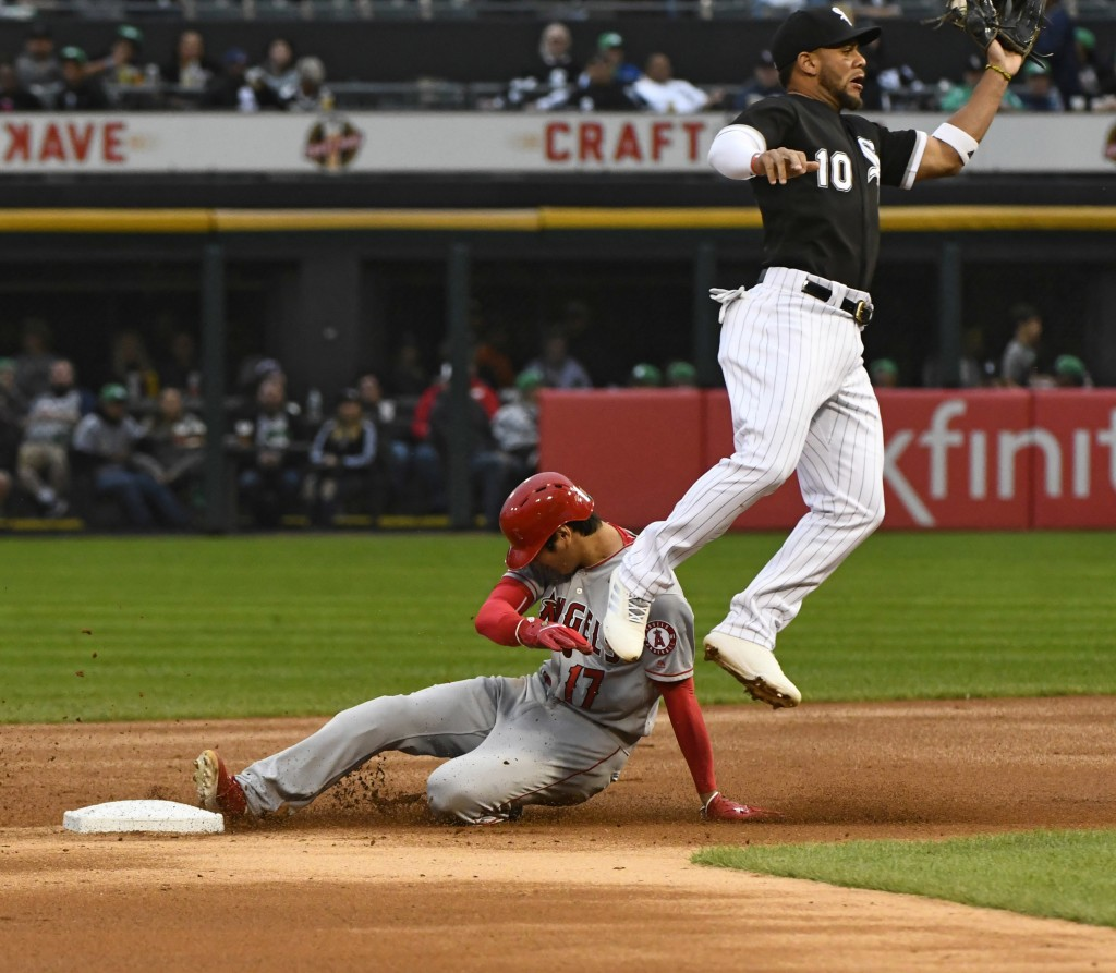 Los Angeles Angels' Shohei Ohtani (17) steals second base under Chicago White Sox second baseman Yoan Moncada (10) during the first inning of a baseba...