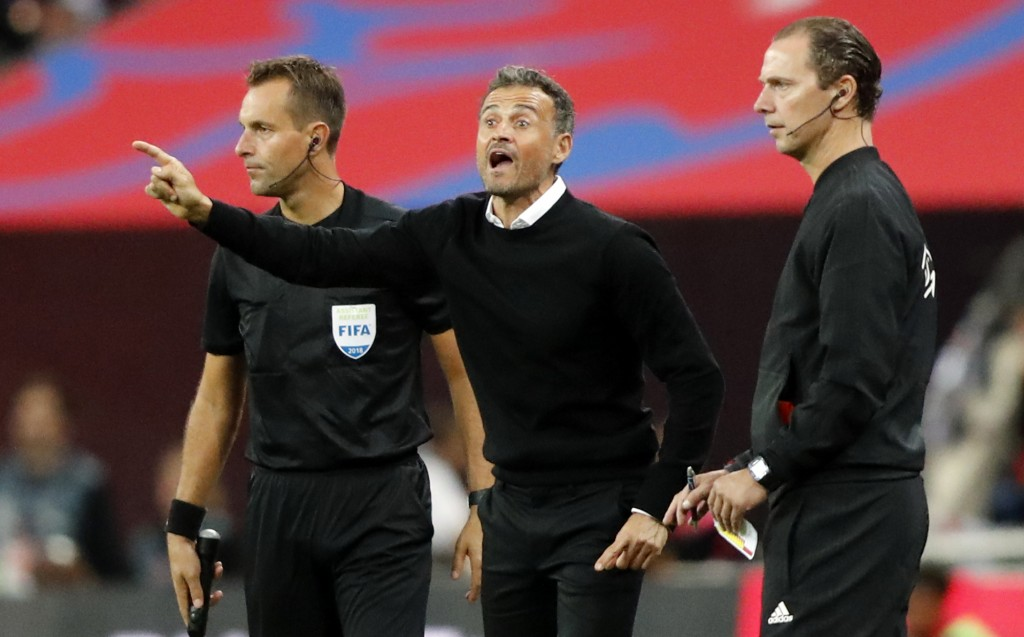 Spain head coach Luis Enrique, center, gestures during the UEFA Nations League soccer match between England and Spain at Wembley stadium in London, Sa