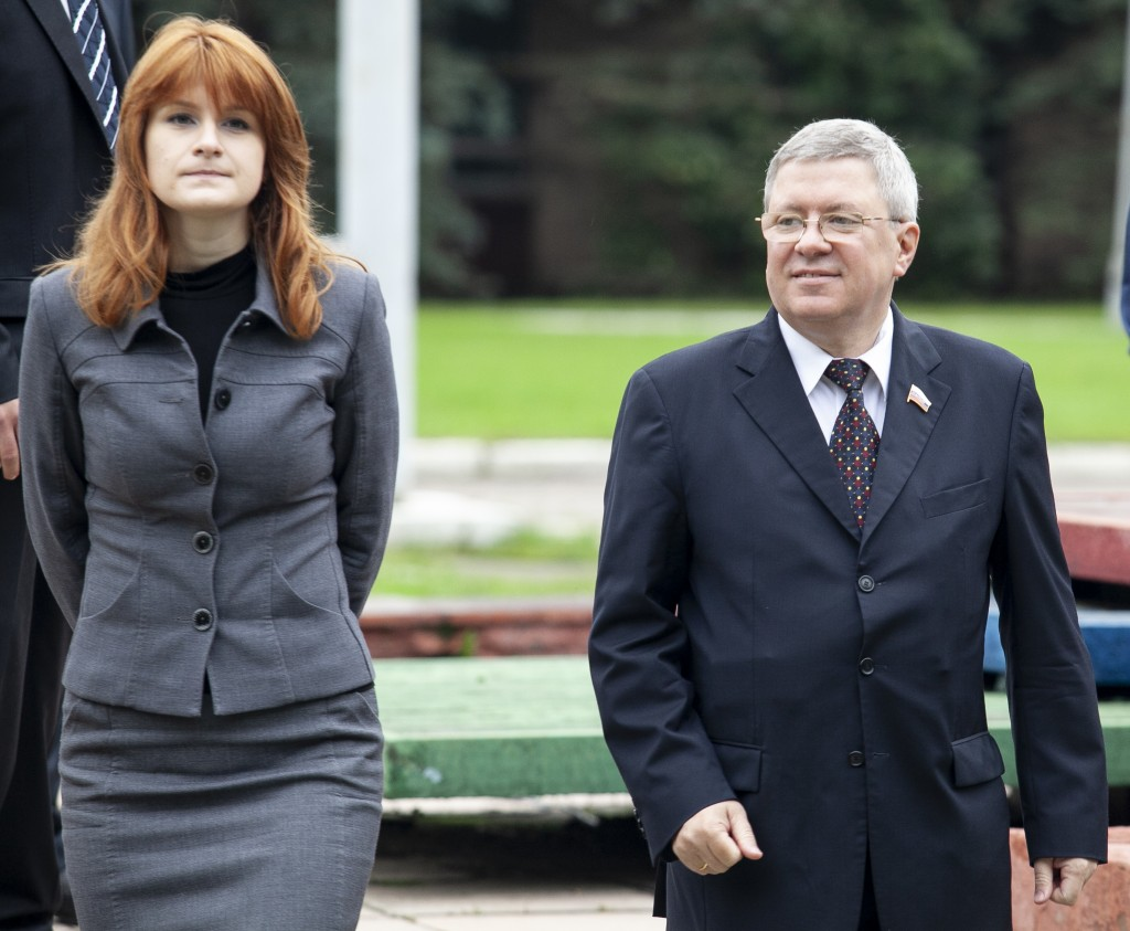 In this photo taken on Friday, Sept. 7, 2012, Maria Butina walks with Alexander Torshin then a member of the Russian upper house of parliament in Mosc...