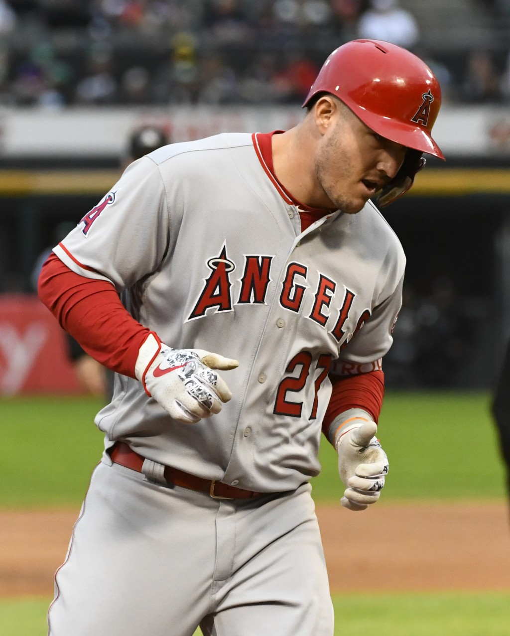 Los Angeles Angels' Mike Trout (27) rounds the bases after he hit a two run home run during the first inning of a baseball game against the Chicago Wh...