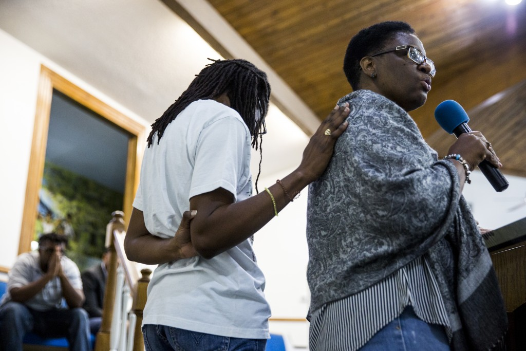 Allison Jean gives remarks about her son, Botham Shem Jean, as she is comforted by her daughter during a prayer vigil for her son at the Dallas West C