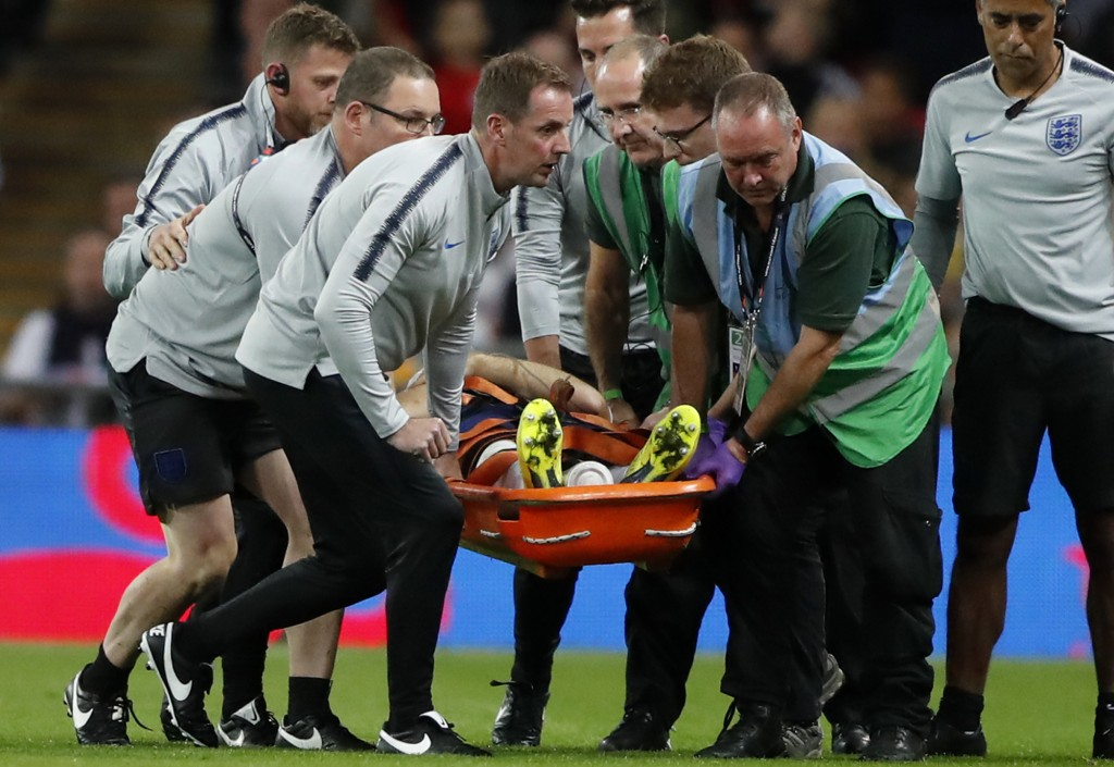 England's Luke Shaw is carried off the pitch on a stretcher after he injured himself during the UEFA Nations League soccer match between England and S
