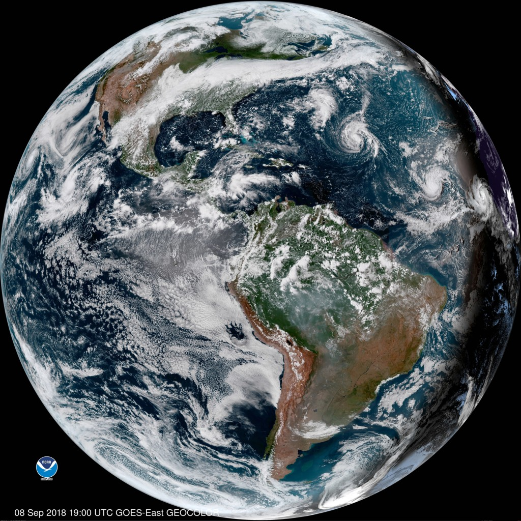 This enhanced satellite image made available by NOAA shows Tropical Storm Florence, third from right, in the Atlantic Ocean on Saturday, Sept. 8, 2018...